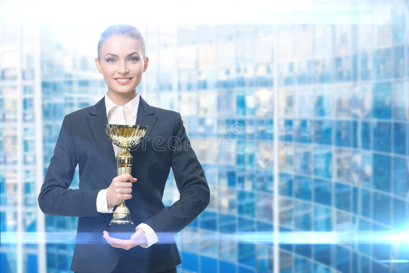 Portrait of business woman keeping gold cup stock photos