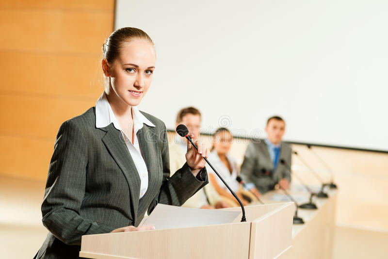 Portrait of a business woman with microphone royalty free stock photos