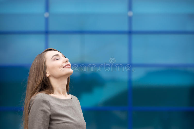 Portrait of business woman relaxing and feeling happy. Copy space stock image