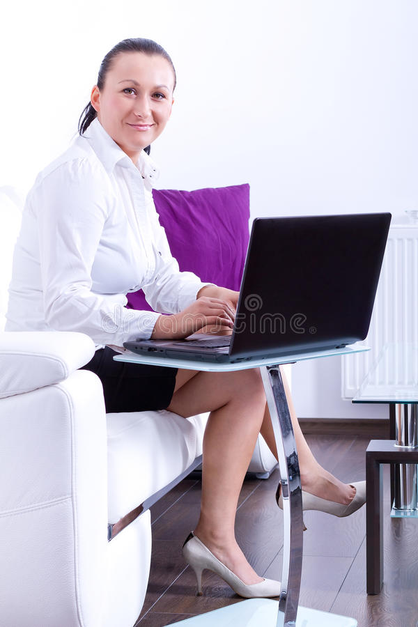 Portrait of business woman sitting with laptop