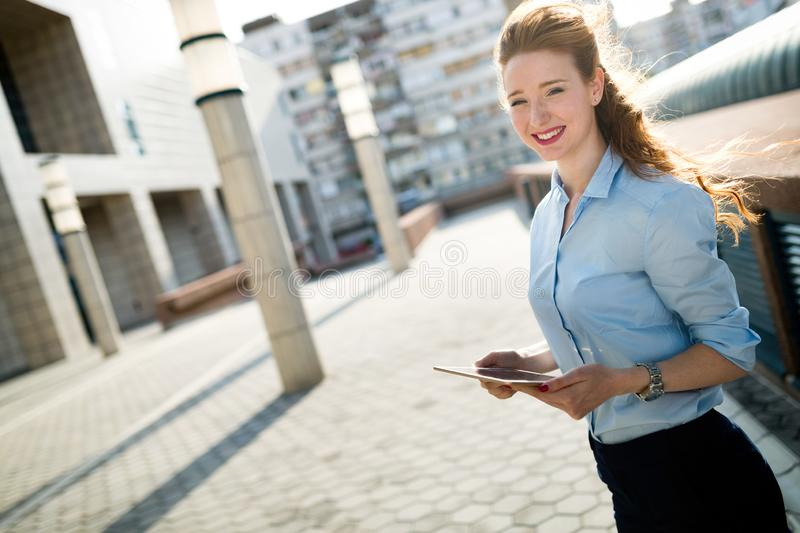 Portrait of business woman smiling outdoor royalty free stock photo
