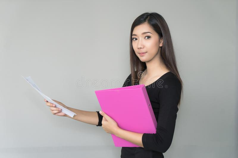 Portrait business woman holding business folder in hands. stock photo
