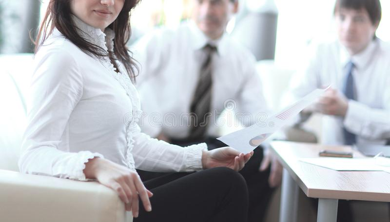 Portrait of business woman on the background of colleagues stock images