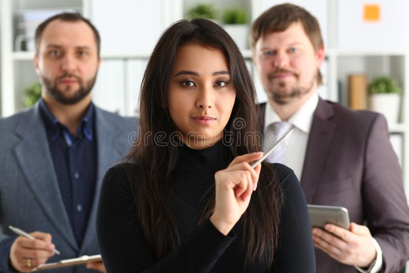 Portrait of businesslady and two businessmen in office royalty free stock images