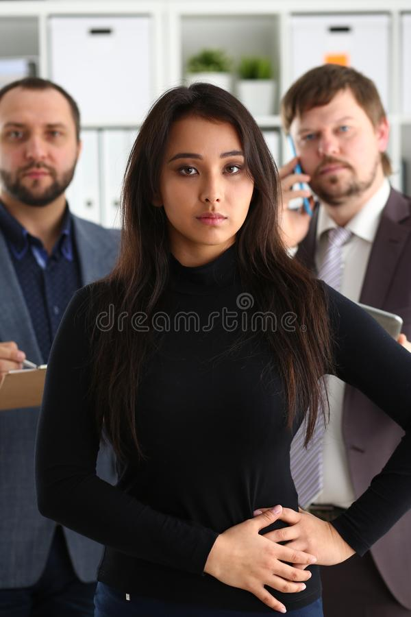 Portrait of businesslady and two businessmen in office royalty free stock photo