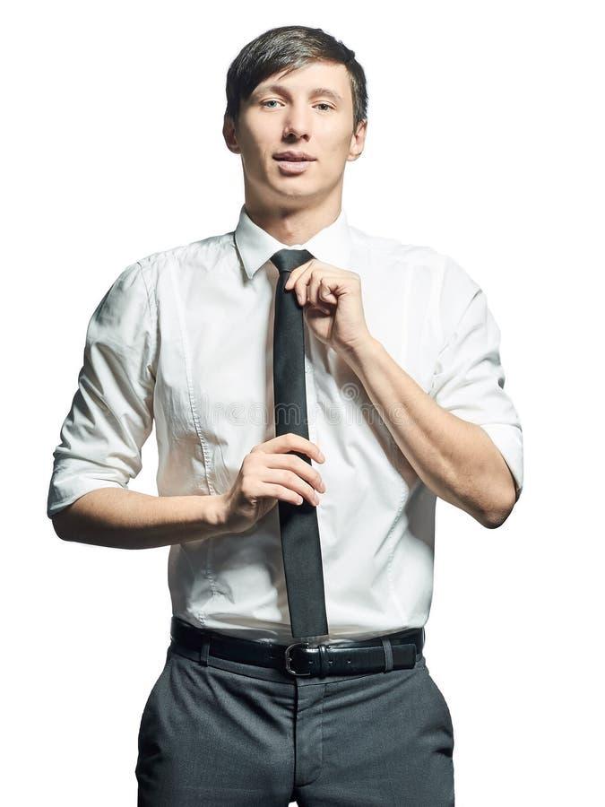 Portrait of businessman adjusting tie on neck stock photography
