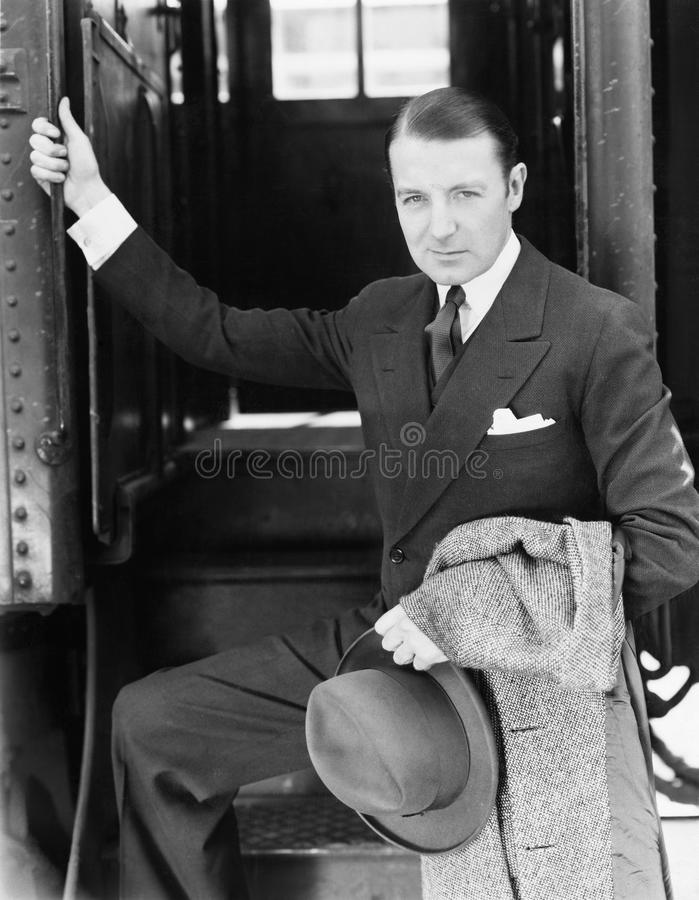Portrait of a businessman boarding a train royalty free stock images