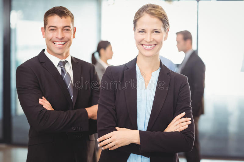 Portrait of businessman and businesswoman smiling stock photo