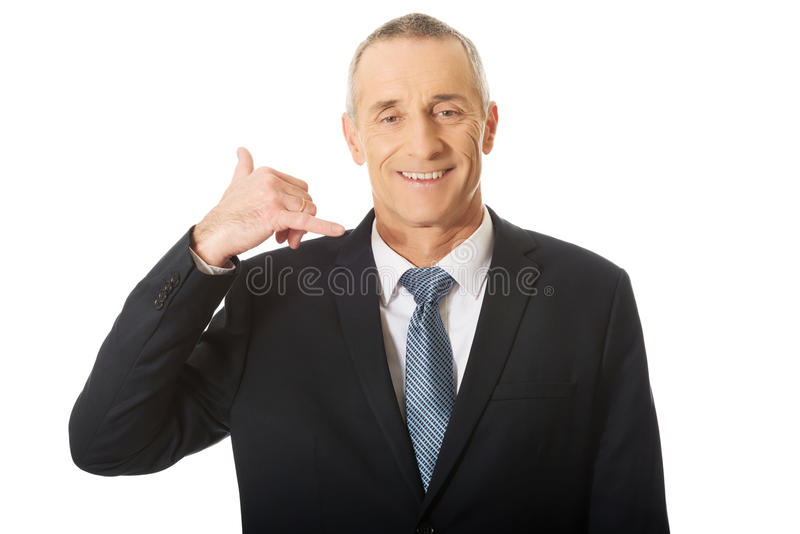 Portrait of businessman with call me gesture royalty free stock photo