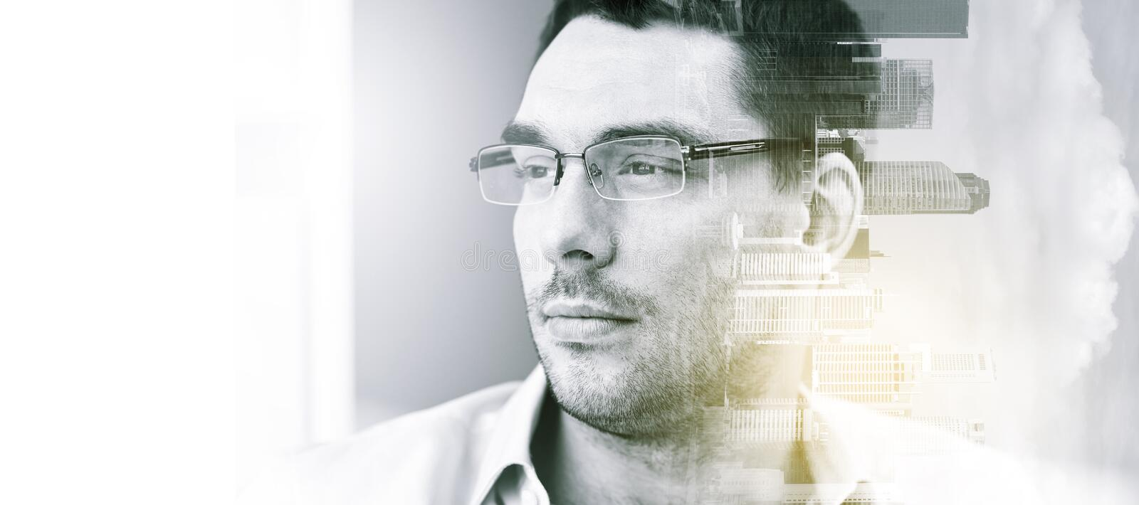 Portrait of businessman in eyeglasses at office stock images