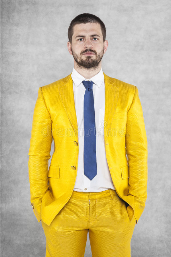 Portrait of a businessman in a gold suit. Portrait of a business man in a gold suit royalty free stock photography