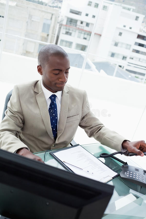 Portrait of a businessman hanging up royalty free stock photos