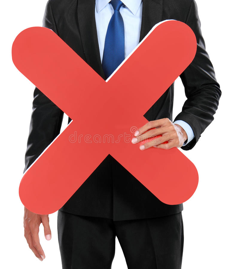 Portrait of businessman holding red cross sign stock image