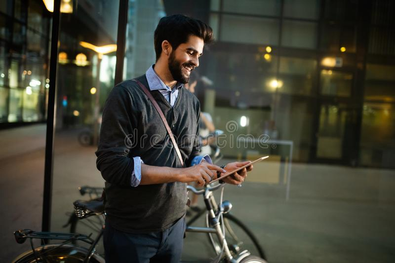 Portrait of young businessman holding tablet outdoor stock photos