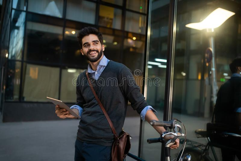 Portrait of young businessman holding tablet outdoor royalty free stock photo