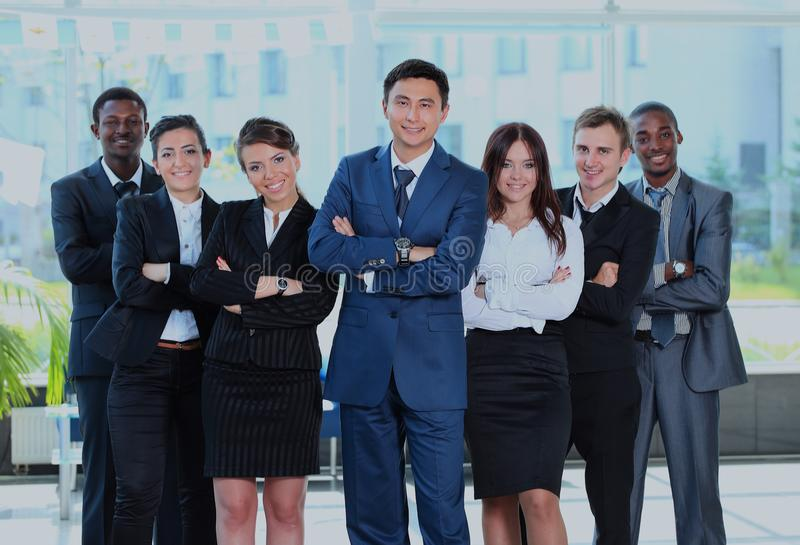 Portrait of businessman leading his team at office. stock image