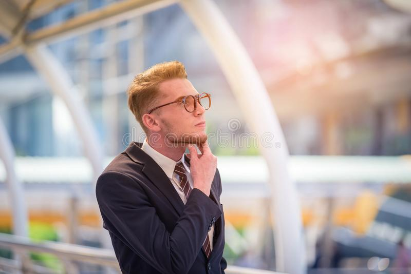 Portrait of businessman looking the future on blurred city backg. Round. Business success concept royalty free stock photo
