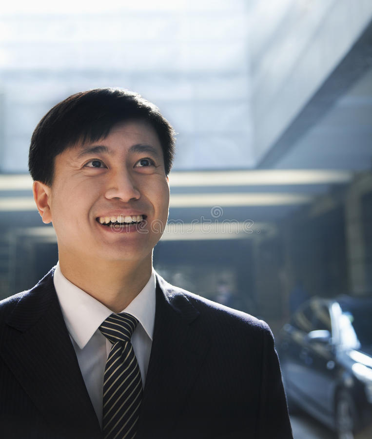 Download Portrait Of Businessman Looking Up In A Parking Garage Stock Photo - Image: 36767340