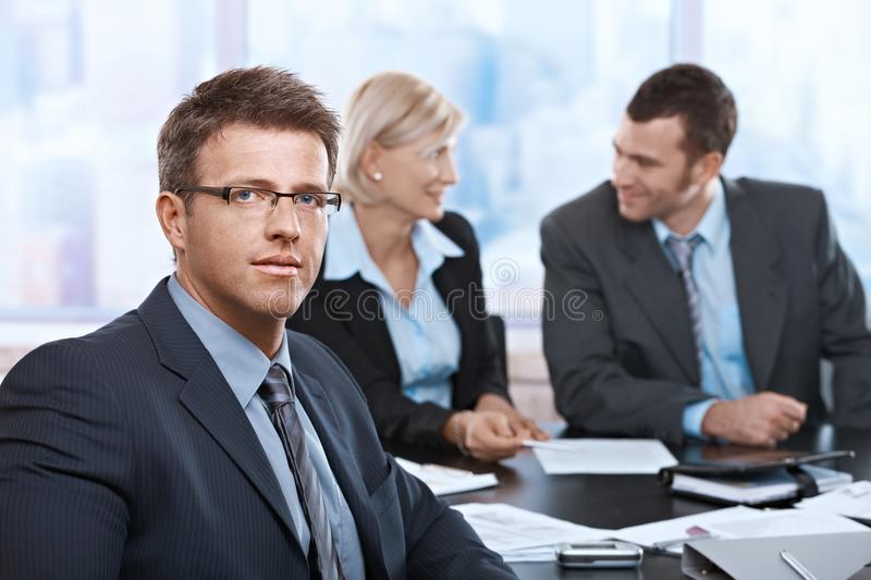 Download Portrait Of Businessman At Meeting Stock Photo - Image: 24850484