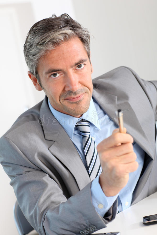 Portrait of businessman in negotiation stock photography