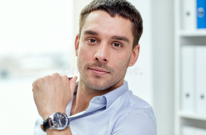 Portrait of businessman in office stock photos