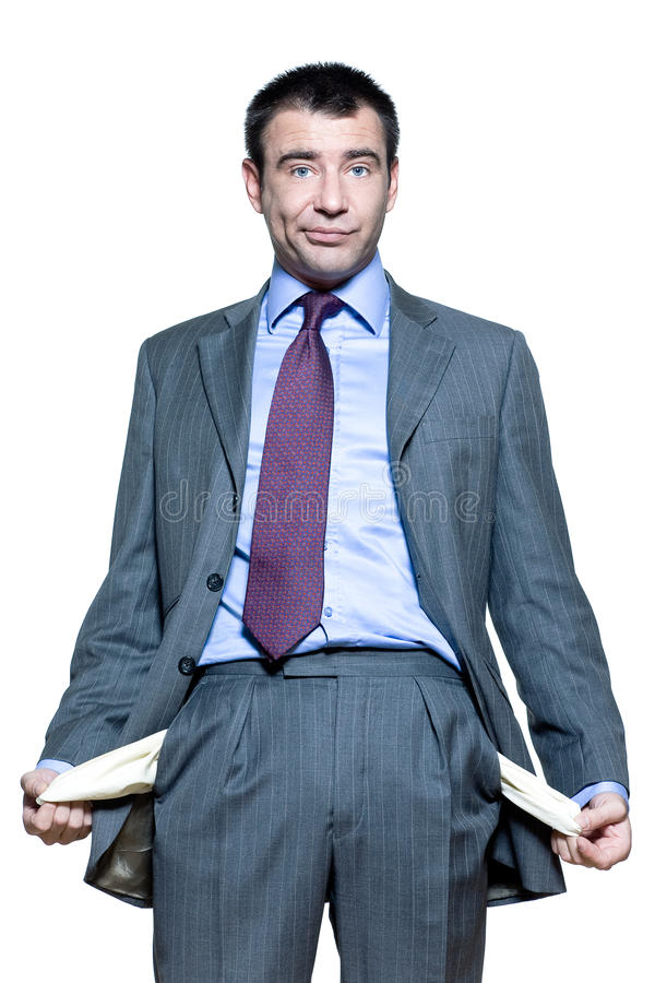 Portrait of businessman showing his empty pockets stock photo