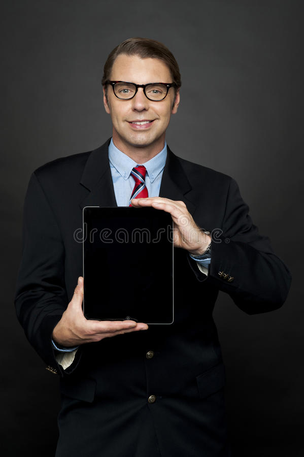 Download Portrait Of Businessman Showing New Digital Device Royalty Free Stock Images - Image: 26567059