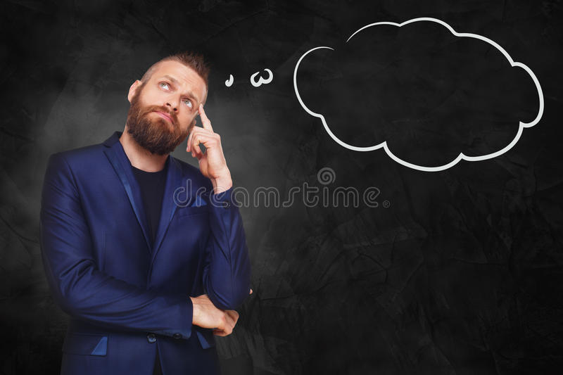 Portrait of a businessman with thinking cloud royalty free stock photography