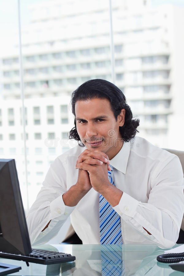 Portrait of a businessman thinking while using a monitor royalty free stock photo