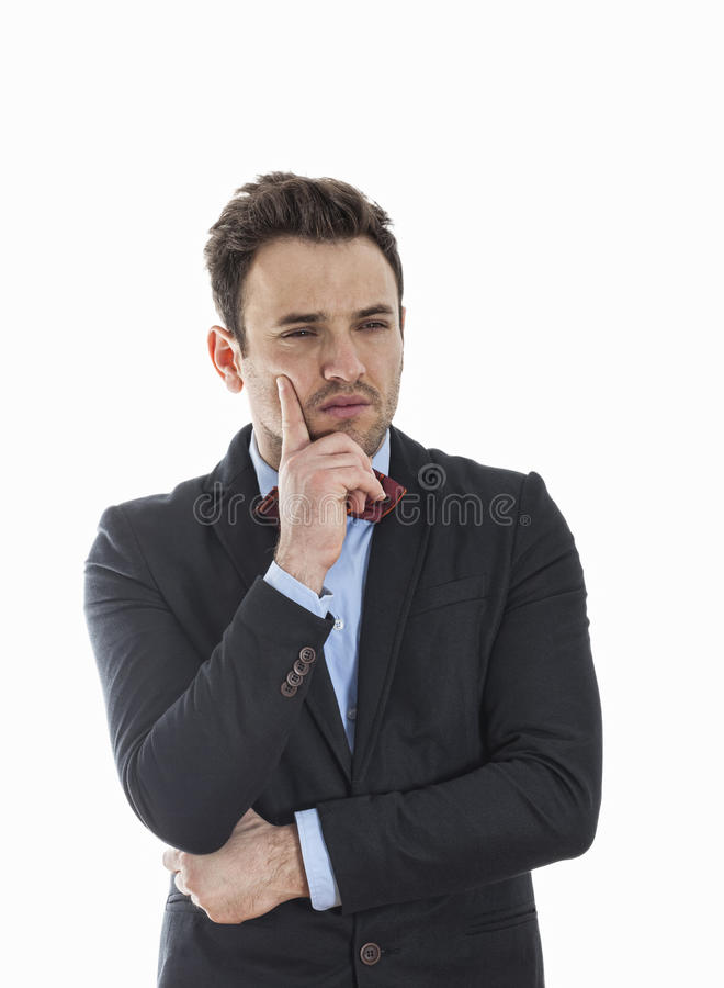 Portrait of a Businessman Thinking. Portrait of a young busineesman thinking, isolated against a white background royalty free stock photos