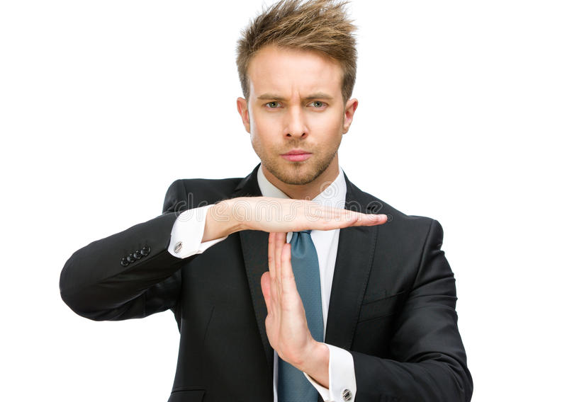 Portrait of businessman time out gesturing. Half-length portrait of businessman time out gesturing, isolated on white royalty free stock image