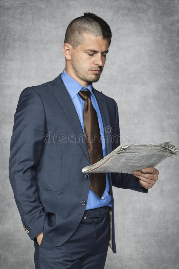 Portrait of a businessman who reads stock image