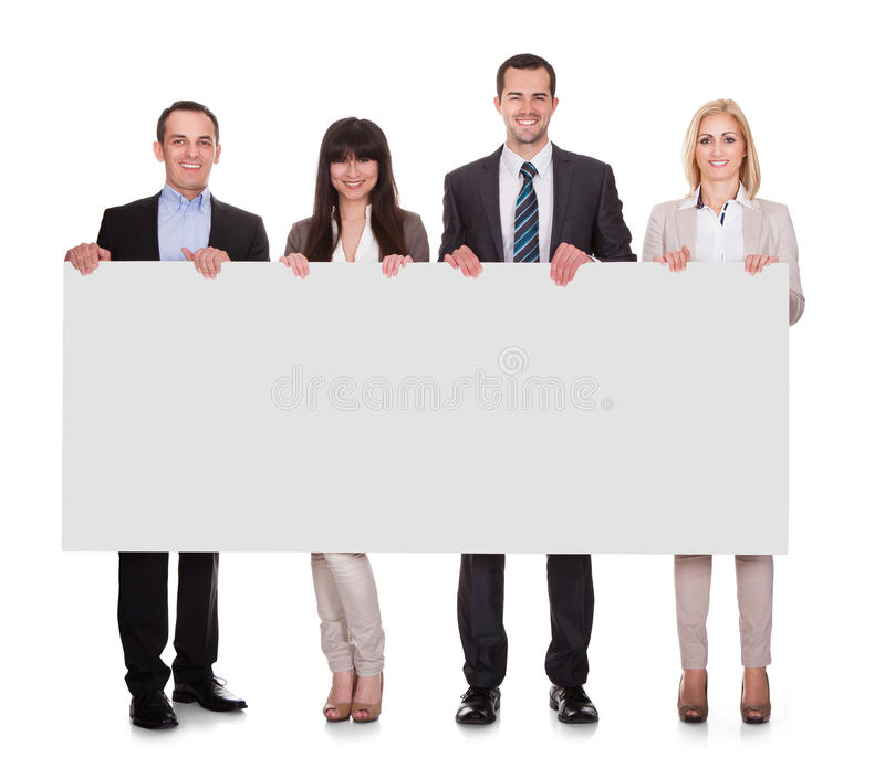 Portrait of businesspeople group holding placard royalty free stock photography