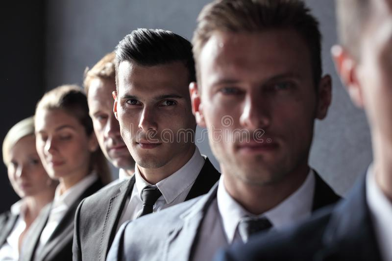 Portrait of businesspeople in a row royalty free stock photo