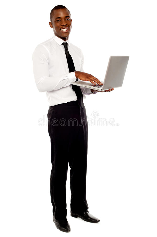 Portrait of businessperson holding laptop
