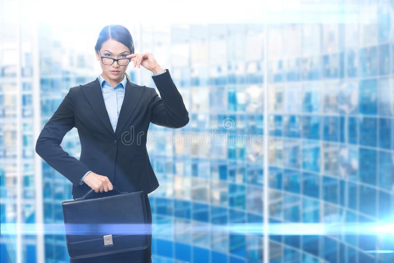 Portrait of businesswoman with case stock photos