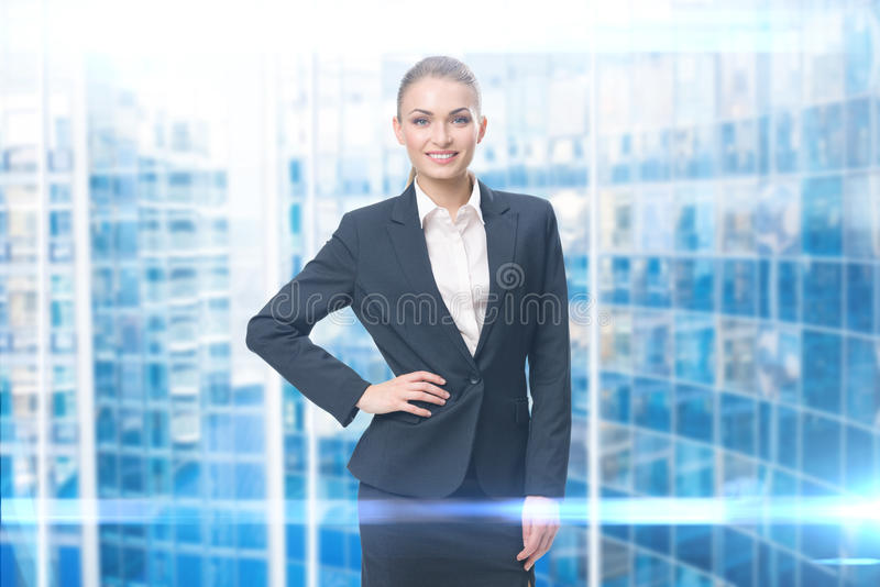 Portrait of businesswoman with hand on hip stock image