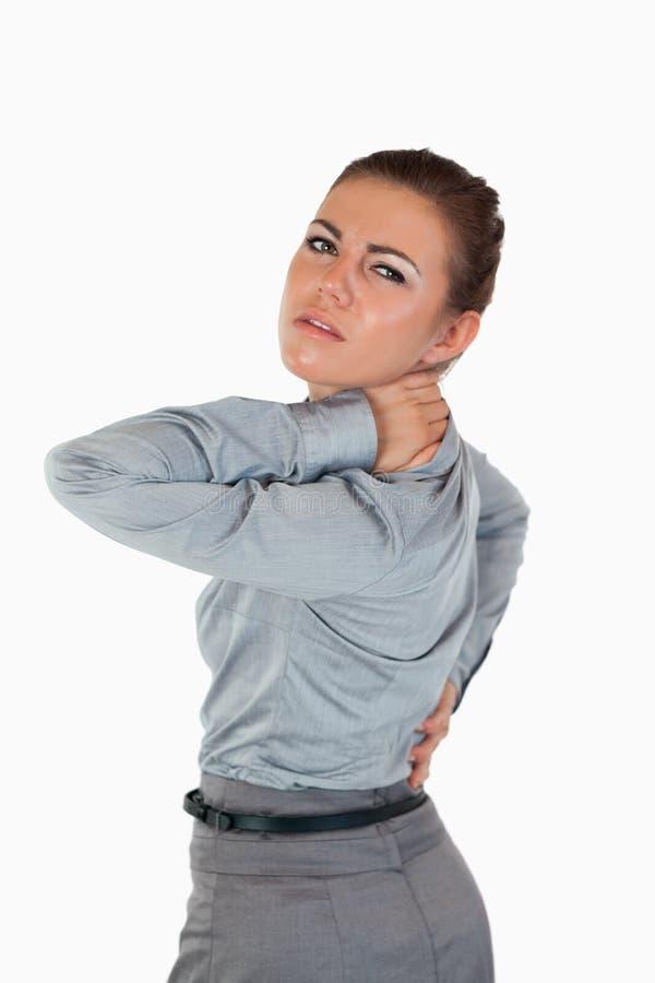 Portrait of a businesswoman having back pain stock photo