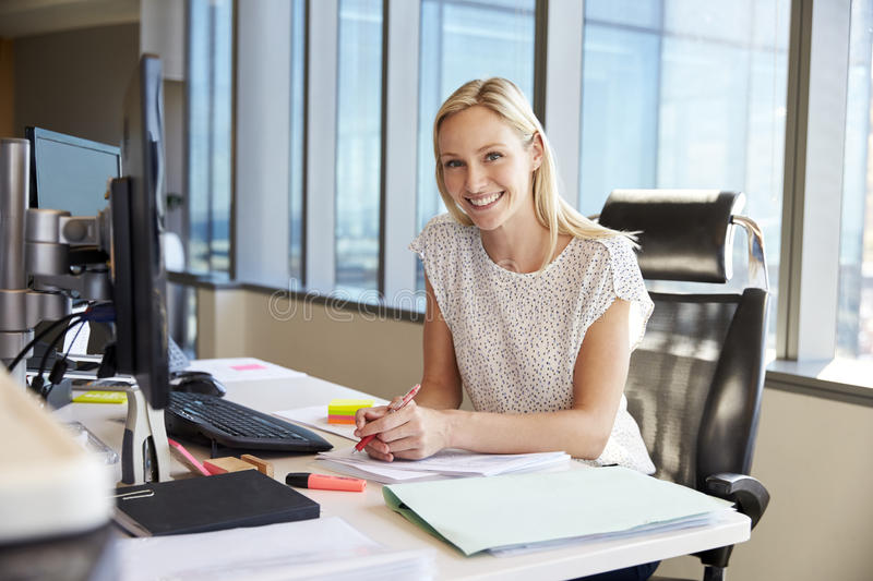 Portrait Of Businesswoman At Office Desk Using Computer royalty free stock images