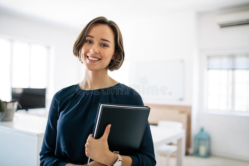 Portrait of a businesswoman in office royalty free stock photography
