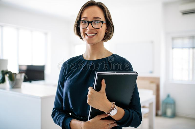 Portrait of a businesswoman in office royalty free stock photos