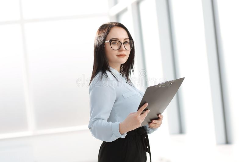 Portrait of a businesswoman standing near the office window royalty free stock image