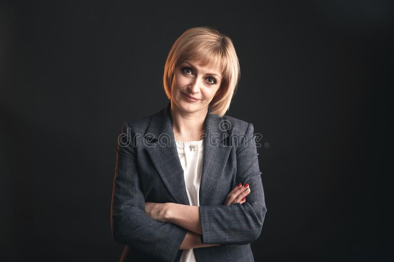 Portrait of businesswoman in a studio isolated on the grey background. royalty free stock photos