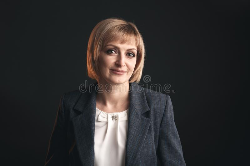 Portrait of businesswoman in the suit isolated in a studio. Portrait of businesswoman in the suit isolated in a studio royalty free stock image