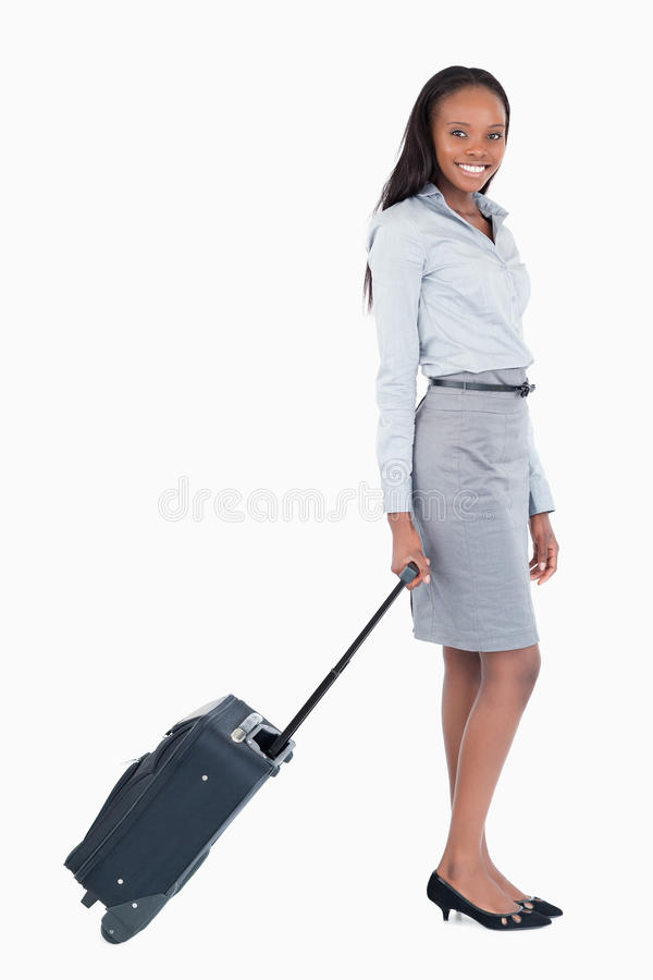 Portrait of a businesswoman with a suitcase