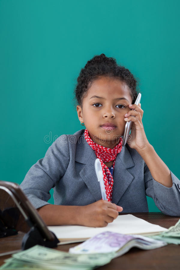 Portrait of businesswoman talking on mobile phone stock image