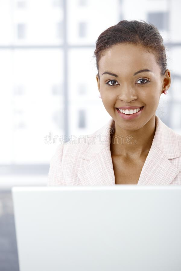 Download Portrait Of Businesswoman Using Laptop Stock Photo - Image: 19263616