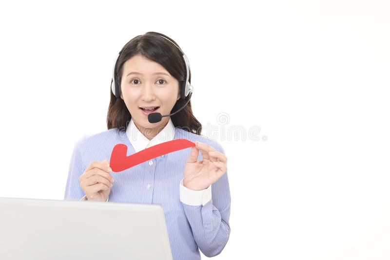 Call center operator with a check mark. Portrait of a call center operator royalty free stock images