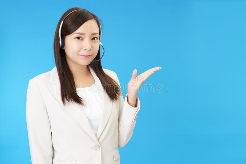 Smiling call center operator royalty free stock image