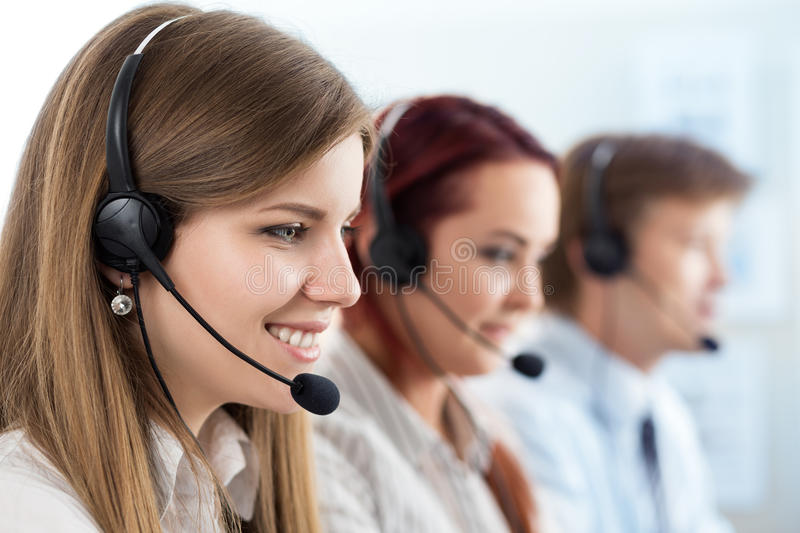 Portrait of call center worker accompanied by her team stock photos